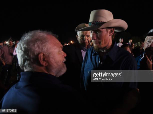 Stephen Willeford and Johnnie Langendorff who both chased after suspected killer Devin Kelley meet again during a vigil in Sutherland Springs Texas...