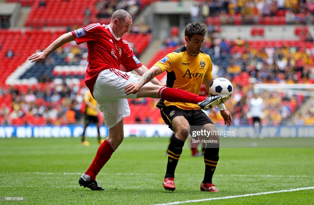 Stephen Wright of Newport battles with Andy Sandell of Newport during the Blue Square Bet Premier Conference Play-off Final match between Wrexham and Newport County A.F.C at Wembley Stadium on May 05, 2013 in London, England.