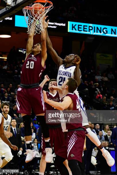 J Stephens of the Lafayette Leopards battles with Dhamir CosbyRoundtree of the Villanova Wildcats during the second half at the PPL Center on...