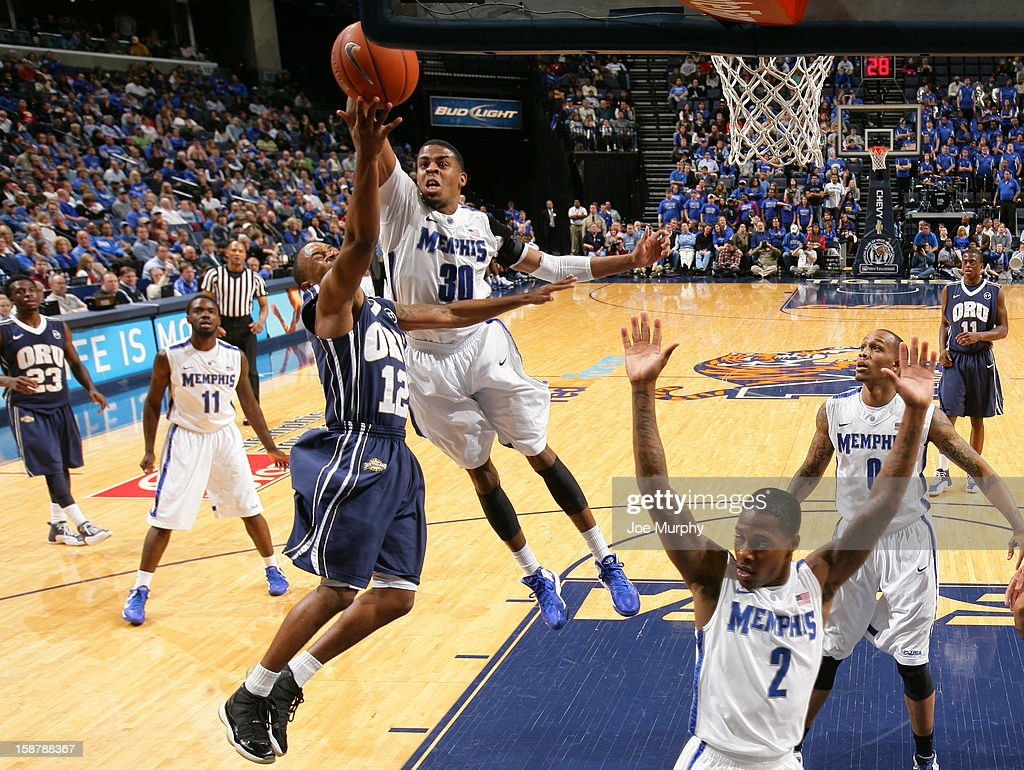 D.J. Stephens #30 of the Memphis Tigers blocks a shot attempt by D.J. Jackson #12 of the Oral Roberts Golden Eagles on December 28, 2012 at FedExForum in Memphis, Tennessee.