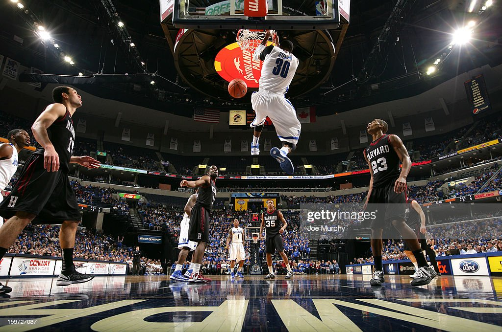 D.J. Stephens #30 of the Memphis Tigers dunks the ball against the Harvard Crimson on January 19, 2013 at FedExForum in Memphis, Tennessee.