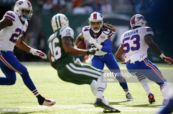 Stephon Gilmore of the Buffalo Bills returns an interception in the first quarter against the New York Jets at MetLife Stadium on October 26 2014 in...