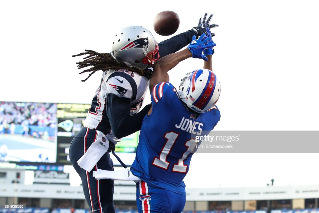 Stephon Gilmore #24 of the New England Patriots attempts to break up a pass to Zay Jones #11 of the Buffalo Bills during the fourth quarter on December 3, 2017 at New Era Field in Orchard Park, New York.