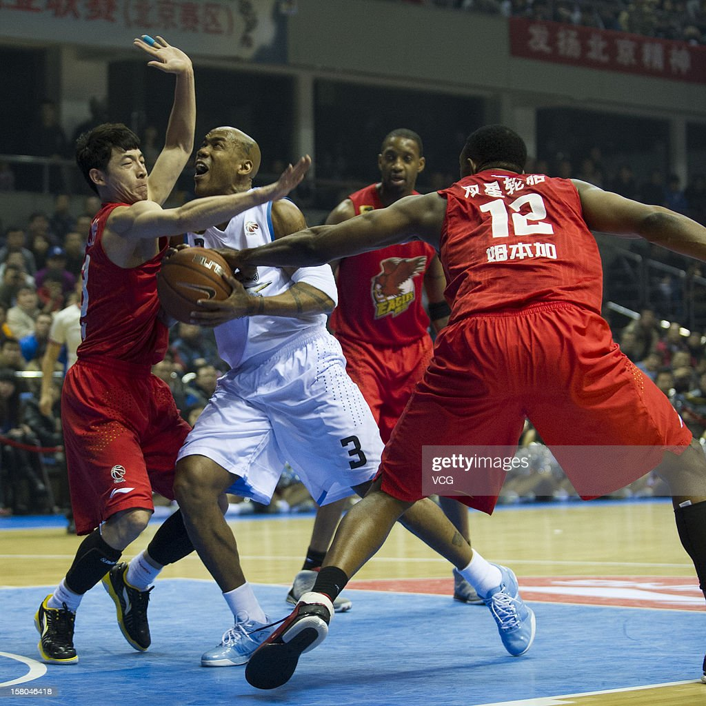 <a gi-track='captionPersonalityLinkClicked' href=/galleries/search?phrase=Stephon+Marbury&family=editorial&specificpeople=201496 ng-click='$event.stopPropagation()'>Stephon Marbury</a> #3 of Beijing Ducks drives the ball during the seventh round of the CBA 12/13 game against Qingdao Eagles at Shougang Basketball Centre on December 9, 2012 in Beijing, China.