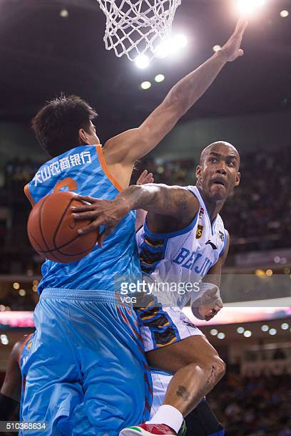 Stephon Marbury of Beijing Ducks handles the ball during the Chinese Basketball Association 15/16 season playoff quarterfinal match between Beijing...