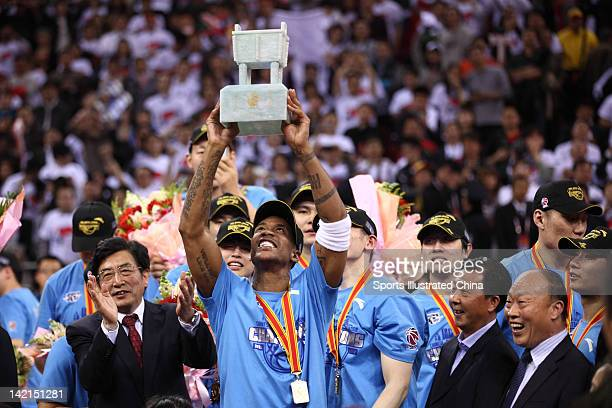 Stephon Marbury of the Beijing Ducks celebrates with the trophy after winning Game 5 the 2012 CBA Championship Finals against the Guangdong Southern...