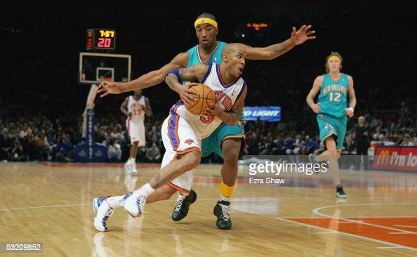 Stephon Marbury of the New York Knicks drives against JR Smith of the New Orleans Hornets on January 11 2005 at Madison Square Garden in New York City