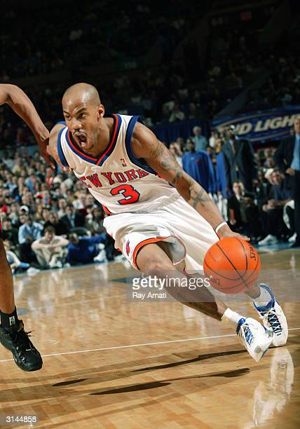Stephon Marbury of the New York Knicks drives towards the basket against the Toronto Raptors on March 26 2004 at Madison Square Garden in New York...