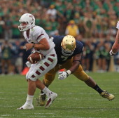 Stephon Tuitt of the Notre Dame Fighting Irish sacks Connor Reilly of the Temple Owls at Notre Dame Stadium on August 31 2013 in South Bend Indiana