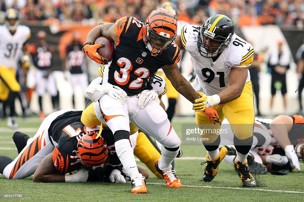 <a gi-track='captionPersonalityLinkClicked' href=/galleries/search?phrase=Stephon+Tuitt&family=editorial&specificpeople=8563449 ng-click='$event.stopPropagation()'>Stephon Tuitt</a> #91 of the Pittsburgh Steelers tackles <a gi-track='captionPersonalityLinkClicked' href=/galleries/search?phrase=Jeremy+Hill+-+American+Football+Player&family=editorial&specificpeople=11392891 ng-click='$event.stopPropagation()'>Jeremy Hill</a> #32 of the Cincinnati Bengals during the first quarter at Paul Brown Stadium on December 13, 2015 in Cincinnati, Ohio.