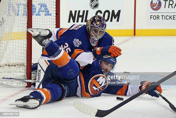 Stephon Williams and Johnny Boychuk of the New York Islanders defend against the Philadelphia Flyers during a preseason game at the Barclays Center...