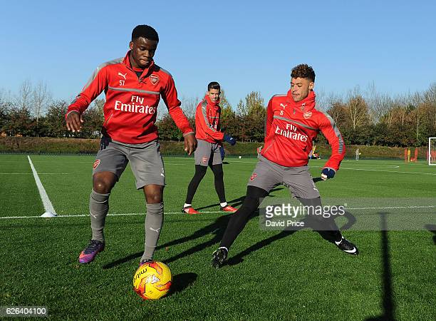 Stephy Mavididi and Alex OxladeChamberlain of Arsenal during Arsenal Training Session at London Colney on November 29 2016 in St Albans England