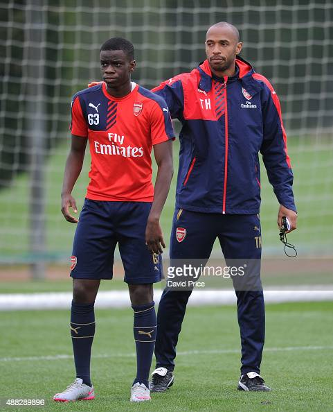 Stephy Mavididi of Arsenal and Thierry Henry assisting with the coaching session during the U19 training session at London Colney on September 15...