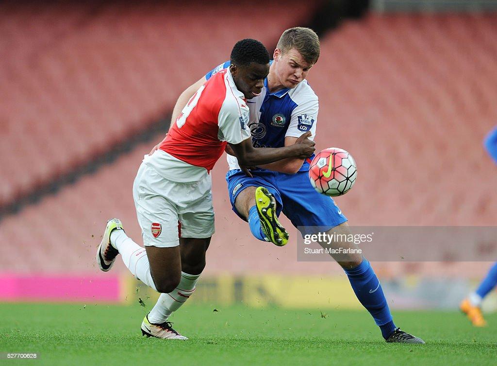 Stephy Mavididi of Arsenal challenged by Matty Platt of Blackburn during the Barclays U21 Premier League match between Arsenal and Blackburn Rovers at Emirates Stadium on May 3, 2016 in London, England.