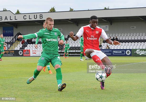 Stephy Mavididi of Arsenal controls the ball under pressure from Milen Mladenov of Ludogorets during the match between Arsenal and Ludogorets Razgrad...