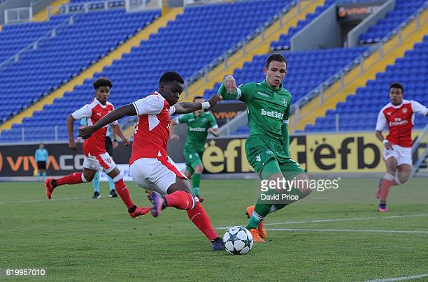 Stephy Mavididi of Arsenal crosses under pressure from Preslav Petrov of Ludogorets during the match between PFC Ludogorets Ragrad and Arsenal in the...