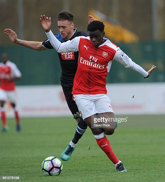 Stephy Mavididi of Arsenal is tripped by Alex Cover of Derby during the match between Arsenal U23 and Derby County U23 at London Colney on January 6...
