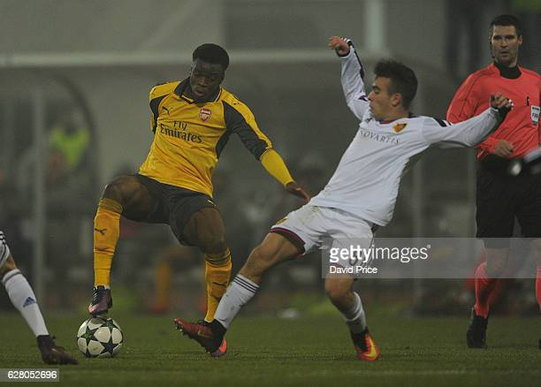Stephy Mavididi of Arsenal takes on Alessandro Stabile of Basel during the UEFA Champions League match between FC Basel and Arsenal at Leichtathletik...