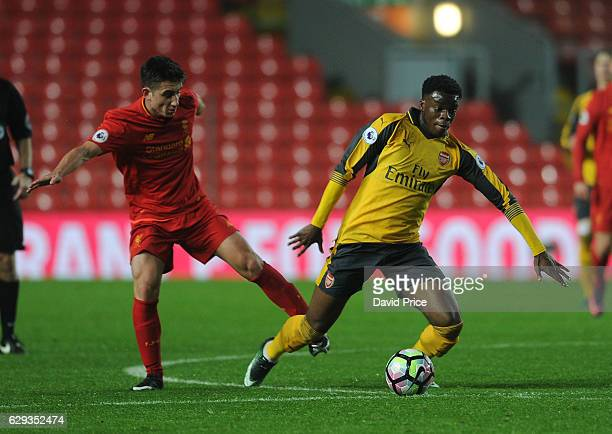 Stephy Mavididi of Arsenal takes on Cameron Brannagan of Liverpool during the Premier League match between Arsenal and Stoke City at Anfield on...