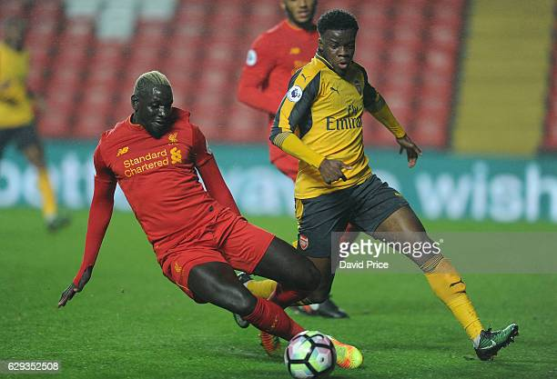Stephy Mavididi of Arsenal takes on Mamadou Sakho of Liverpool during the Premier League match between Arsenal and Stoke City at Anfield on December...