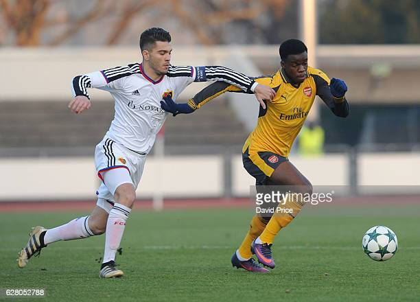 Stephy Mavididi of Arsenal takes on Pedro Pacheco of Basel during the UEFA Champions League match between FC Basel and Arsenal at Leichtathletik...