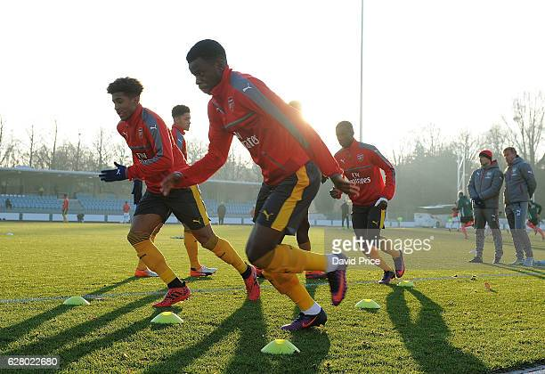 Stephy Mavididi of Arsenal warms up before before the UEFA Champions League match between FC Basel and Arsenal at Leichtathletik Stadion on December...