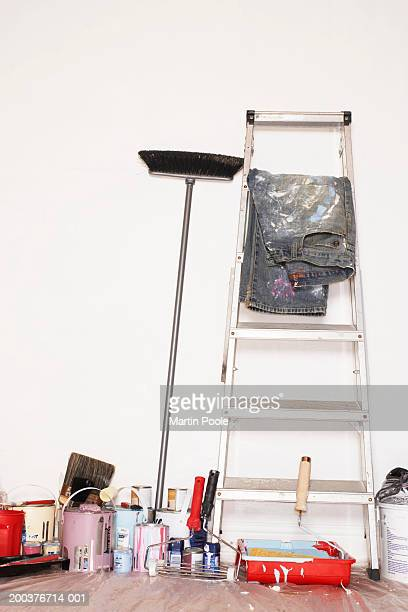 Stepladder and decorating equipment against wall
