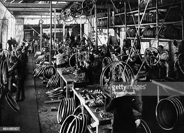 Stepney wheel factory Workers busy producing wheel rims for motor vehicles