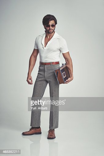 Stepping out with his tunes - 70s style! : Stock Photo
