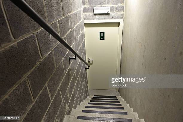 Steps down to exit in cellar basement