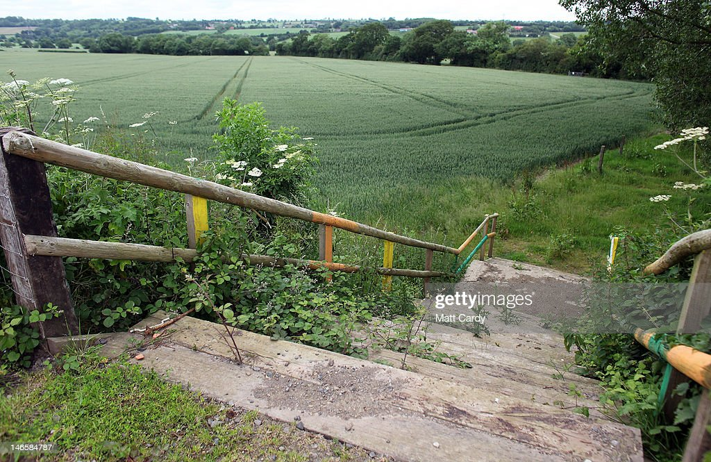 Steps lead into crops growing in what would normally be the Other Stage area at the Glastonbury Festival site at Worthy Farm, Pilton on June 20, 2012 near Glastonbury, England. Today would have been the day that the gates would have opened for what has become Europe's biggest music festival, but because of the London 2012 Olympics it was decided by the organisers to take this year off. However, this week it was announced that the festival - which started in 1970 when several hundred festival-goers paid 1 GBP to watch Marc Bolan and has now attracts more than 175,000 people over five days - will feature in a mosh-pit style tribute in the opening ceremony of the London 2012 Olympic Games. The Festival will return in June 2013.