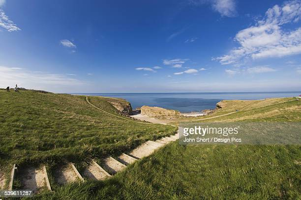 Steps Leading Over The Grassy Slope To The Waters Edge