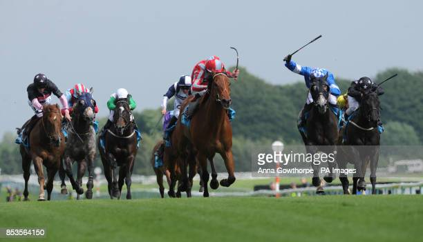 Steps ridden by Kieren Fallon beats Eton Rifles ridden by Pat Smullen to win the Winning Express Achilles Stakes during the Sandy Lane Stakes day at...