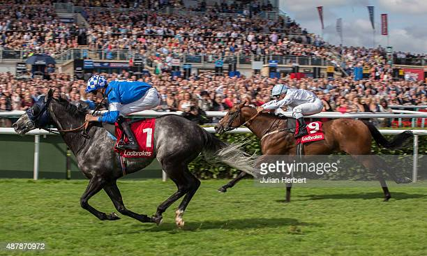 Steps ridden by Louis Steward leads the field home to win The Ladbrokes Portland Race run at Doncaster Racecourse on September 12 2015 in Doncaster...