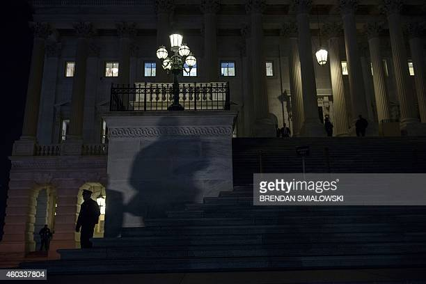 Steps to the US Capitol are seen after the House of Representatives narrowly approved a $11 trillion ninemonth federal spending bill barely two hours...
