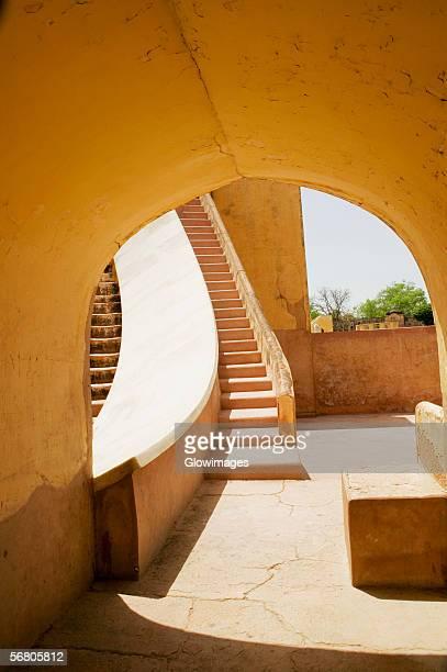 Steps viewed from an arched doorway, Jantar Mantar, Jaipur, Rajasthan, India