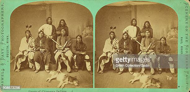 Stereographic card marked Faswell and Davy Photographers Scenery on the Northern Pacific Rail Road depicting a group of six Chippewa men two holding...