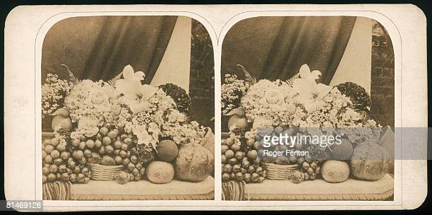 A stereoscopic card depicting a still life with fruit and flowers circa 1865