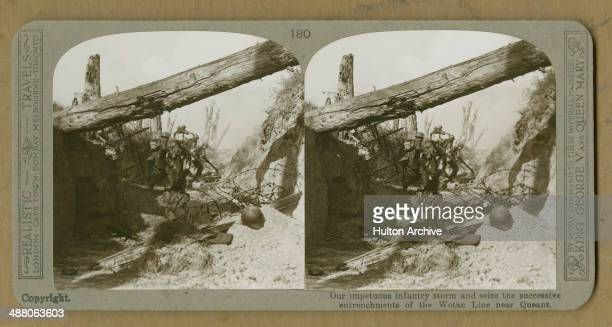 A stereoscopic image of allied infantry storming a German trench on the DrocourtQueant Line near Queant in northern France during World War I 1918...
