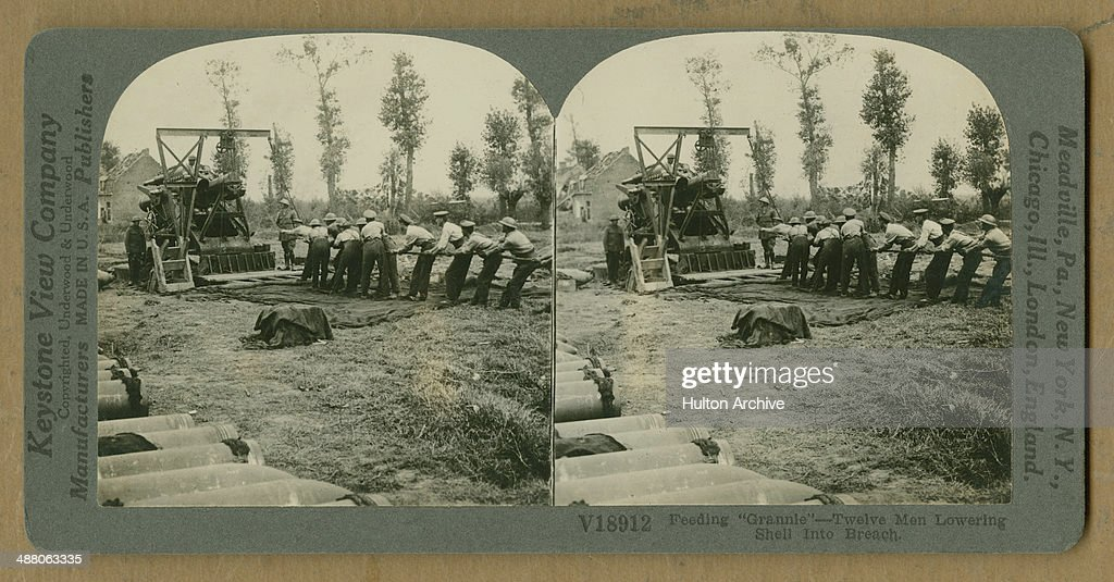 A stereoscopic image of twelve British gunners lowering a shell in to the breach of a twelveinch howitzer during World War I circa 1916 The original...