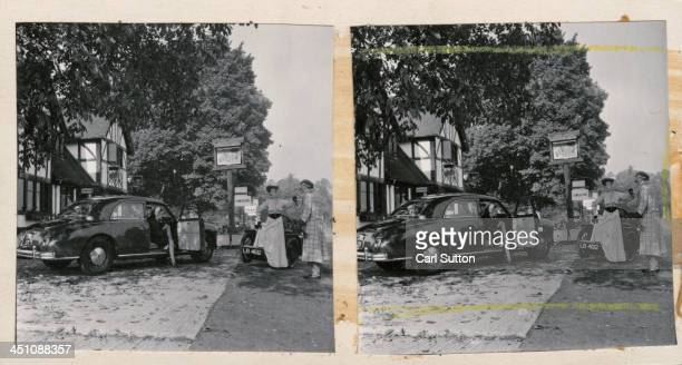 A stereoscopic image pair contrasting a 1903 Riley Tricar threewheeler driven by a couple in Edwardian dress with the latest Riley a Pathfinder which...