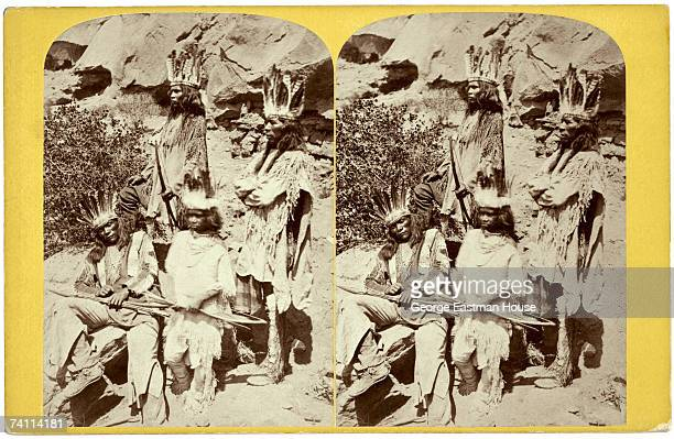 Stereoscopic portrait of a group of four Native Americans possibly from the Ute tribe as they pose with bows in Red Canyon Utah 1870s
