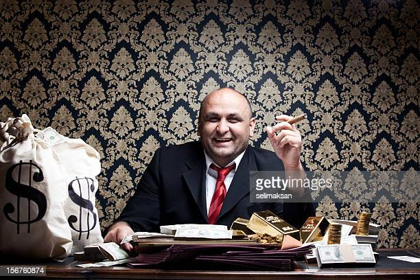Stereotype Rich Man Posing With Money Bags And Dollar Bills