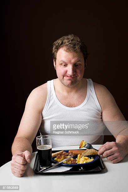 Stereotypical Englishman eating an English breakfast