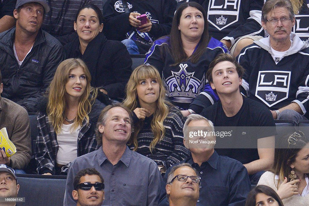 Sterling Beaumon (R) and Mariah Parks (L) attend an NHL playoff game between the San Jose Sharks and the Los Angeles Kings at Staples Center on May 23, 2013 in Los Angeles, California.
