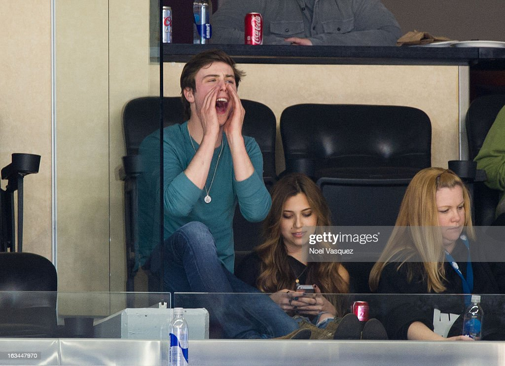 <a gi-track='captionPersonalityLinkClicked' href=/galleries/search?phrase=Sterling+Beaumon&family=editorial&specificpeople=656885 ng-click='$event.stopPropagation()'>Sterling Beaumon</a> (L) and Sacha Edwards attend a hockey game between the Calgary Flames and Los Angeles Kings at Staples Center on March 9, 2013 in Los Angeles, California.