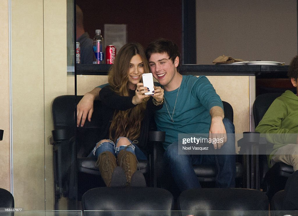 <a gi-track='captionPersonalityLinkClicked' href=/galleries/search?phrase=Sterling+Beaumon&family=editorial&specificpeople=656885 ng-click='$event.stopPropagation()'>Sterling Beaumon</a> (R) and Sacha Edwards attend a hockey game between the Calgary Flames and Los Angeles Kings at Staples Center on March 9, 2013 in Los Angeles, California.