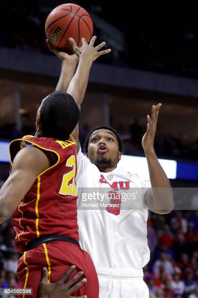 Sterling Brown of the Southern Methodist Mustangs shoots against De'Anthony Melton of the USC Trojans in the first half during the first round of the...