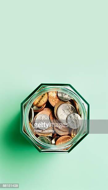 Sterling coins in savings jar.