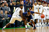 Sterling Gibbs of the Connecticut Huskies handles the ball against Wesley Gordon of the Colorado Buffaloes in the second half as head coach Tad Boyle...
